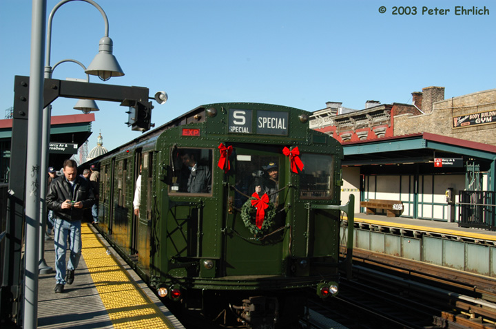 (149k, 720x478)<br><b>Country:</b> United States<br><b>City:</b> New York<br><b>System:</b> New York City Transit<br><b>Line:</b> BMT Nassau Street/Jamaica Line<br><b>Location:</b> Marcy Avenue <br><b>Route:</b> Fan Trip<br><b>Car:</b> R-1 (American Car & Foundry, 1930-1931) 100 <br><b>Photo by:</b> Peter Ehrlich<br><b>Date:</b> 12/28/2003<br><b>Viewed (this week/total):</b> 0 / 3700