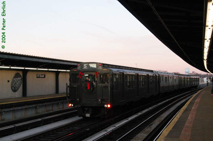 (101k, 720x478)<br><b>Country:</b> United States<br><b>City:</b> New York<br><b>System:</b> New York City Transit<br><b>Line:</b> BMT Nassau Street/Jamaica Line<br><b>Location:</b> 111th Street <br><b>Route:</b> Fan Trip<br><b>Car:</b> R-4 (American Car & Foundry, 1932-1933) 484 <br><b>Photo by:</b> Peter Ehrlich<br><b>Date:</b> 12/28/2003<br><b>Notes:</b> The artwork <i>Five Points of Observation</i> can be seen along the platform wall just to the left of the train.<br><b>Viewed (this week/total):</b> 4 / 2613