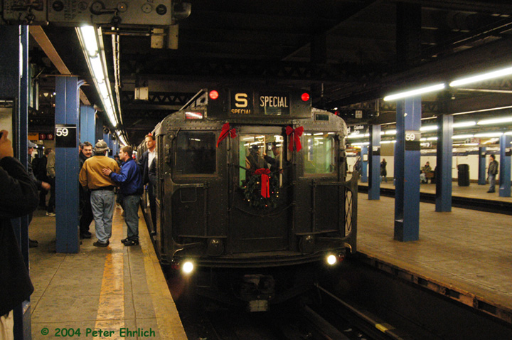 (161k, 720x478)<br><b>Country:</b> United States<br><b>City:</b> New York<br><b>System:</b> New York City Transit<br><b>Line:</b> IND 8th Avenue Line<br><b>Location:</b> 59th Street/Columbus Circle <br><b>Route:</b> Fan Trip<br><b>Car:</b> R-4 (American Car & Foundry, 1932-1933) 484 <br><b>Photo by:</b> Peter Ehrlich<br><b>Date:</b> 12/28/2003<br><b>Viewed (this week/total):</b> 0 / 2538