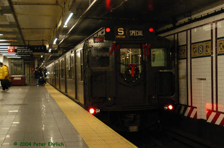 (134k, 720x478)<br><b>Country:</b> United States<br><b>City:</b> New York<br><b>System:</b> New York City Transit<br><b>Line:</b> BMT Canarsie Line<br><b>Location:</b> 8th Avenue <br><b>Route:</b> Fan Trip<br><b>Car:</b> R-4 (American Car & Foundry, 1932-1933) 484 <br><b>Photo by:</b> Peter Ehrlich<br><b>Date:</b> 12/28/2003<br><b>Viewed (this week/total):</b> 6 / 2709