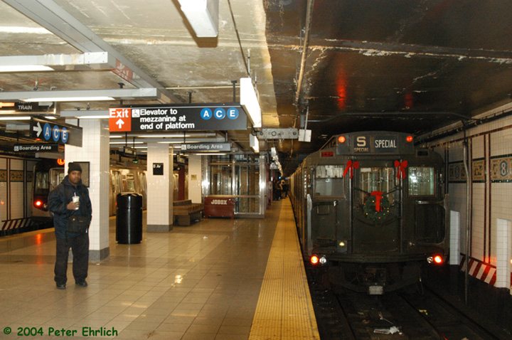 (154k, 720x478)<br><b>Country:</b> United States<br><b>City:</b> New York<br><b>System:</b> New York City Transit<br><b>Line:</b> BMT Canarsie Line<br><b>Location:</b> 8th Avenue <br><b>Route:</b> Fan Trip<br><b>Car:</b> R-4 (American Car & Foundry, 1932-1933) 484 <br><b>Photo by:</b> Peter Ehrlich<br><b>Date:</b> 12/28/2003<br><b>Viewed (this week/total):</b> 1 / 3923
