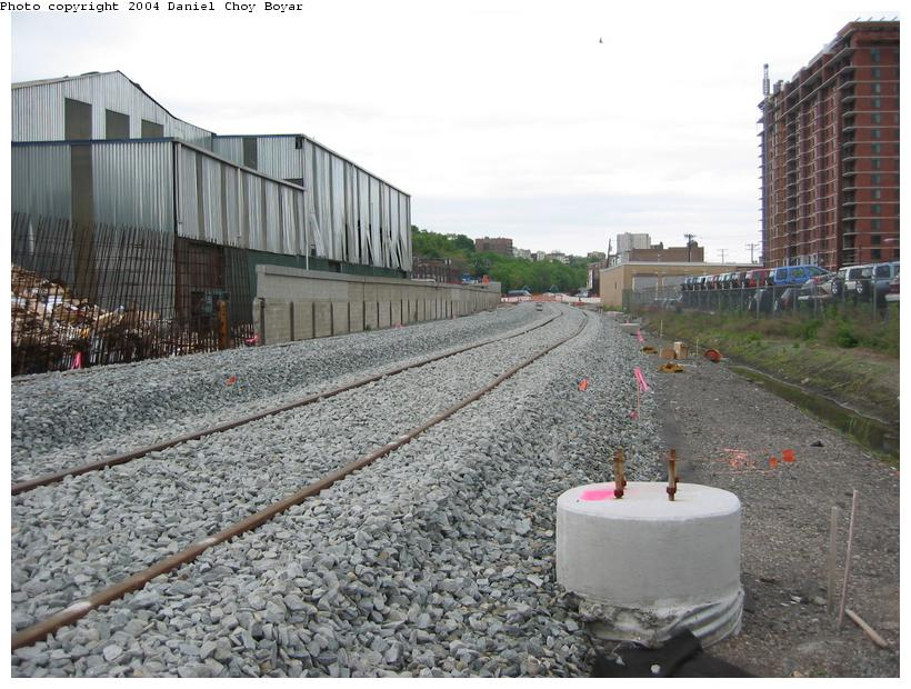 (106k, 820x620)<br><b>Country:</b> United States<br><b>City:</b> Hoboken, NJ<br><b>System:</b> Hudson Bergen Light Rail<br><b>Location:</b> Between Hoboken Wye and Paterson Ave. <br><b>Photo by:</b> Daniel C. Boyar<br><b>Date:</b> 5/16/2003<br><b>Notes:</b> New ROW and catenary tower bases (facing north from Observer Hwy)<br><b>Viewed (this week/total):</b> 0 / 1746