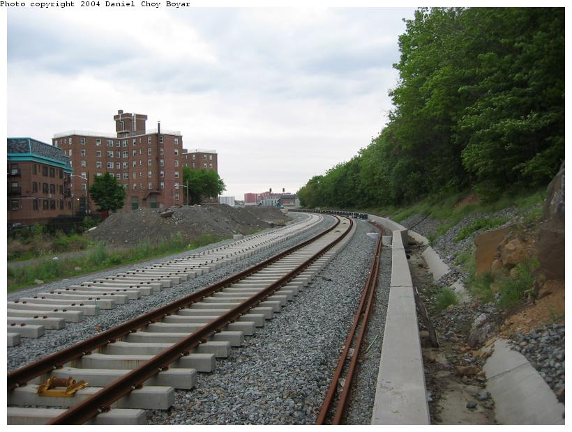 (90k, 820x620)<br><b>Country:</b> United States<br><b>City:</b> Hoboken, NJ<br><b>System:</b> Hudson Bergen Light Rail<br><b>Location:</b> Between 2nd Street and 9th Street <br><b>Photo by:</b> Daniel C. Boyar<br><b>Date:</b> 5/16/2003<br><b>Notes:</b> New track and concrete retaining wall looking south<br><b>Viewed (this week/total):</b> 0 / 1944