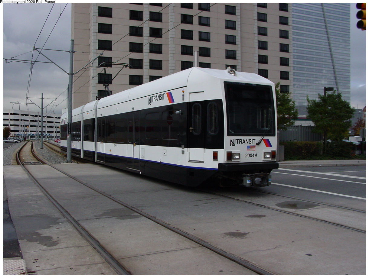 (73k, 820x620)<br><b>Country:</b> United States<br><b>City:</b> Jersey City, NJ<br><b>System:</b> Hudson Bergen Light Rail<br><b>Location:</b> Harsimus Cove <br><b>Car:</b> NJT-HBLR LRV (Kinki-Sharyo, 1998-99)  2004 <br><b>Photo by:</b> Richard Panse<br><b>Date:</b> 10/29/2003<br><b>Viewed (this week/total):</b> 0 / 2278