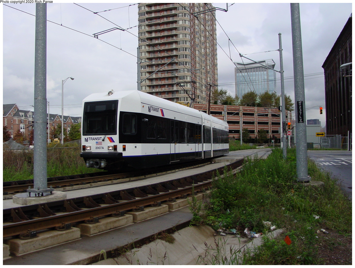 (92k, 820x620)<br><b>Country:</b> United States<br><b>City:</b> Jersey City, NJ<br><b>System:</b> Hudson Bergen Light Rail<br><b>Location:</b> Harsimus Cove <br><b>Car:</b> NJT-HBLR LRV (Kinki-Sharyo, 1998-99)  2007 <br><b>Photo by:</b> Richard Panse<br><b>Date:</b> 10/29/2003<br><b>Viewed (this week/total):</b> 0 / 2053