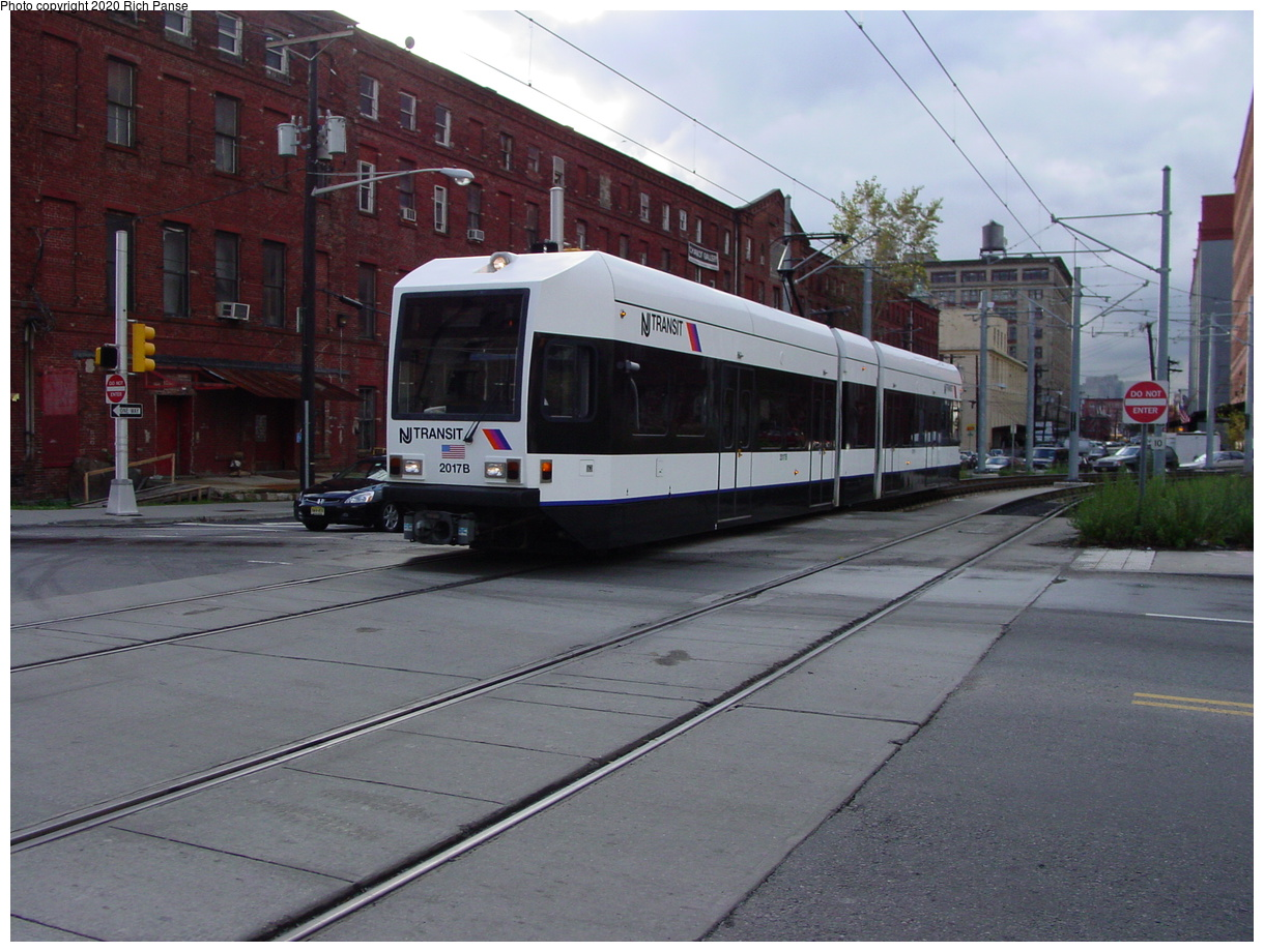 (75k, 820x620)<br><b>Country:</b> United States<br><b>City:</b> Jersey City, NJ<br><b>System:</b> Hudson Bergen Light Rail<br><b>Location:</b> Harsimus Cove <br><b>Car:</b> NJT-HBLR LRV (Kinki-Sharyo, 1998-99)  2017 <br><b>Photo by:</b> Richard Panse<br><b>Date:</b> 10/29/2003<br><b>Viewed (this week/total):</b> 1 / 2088