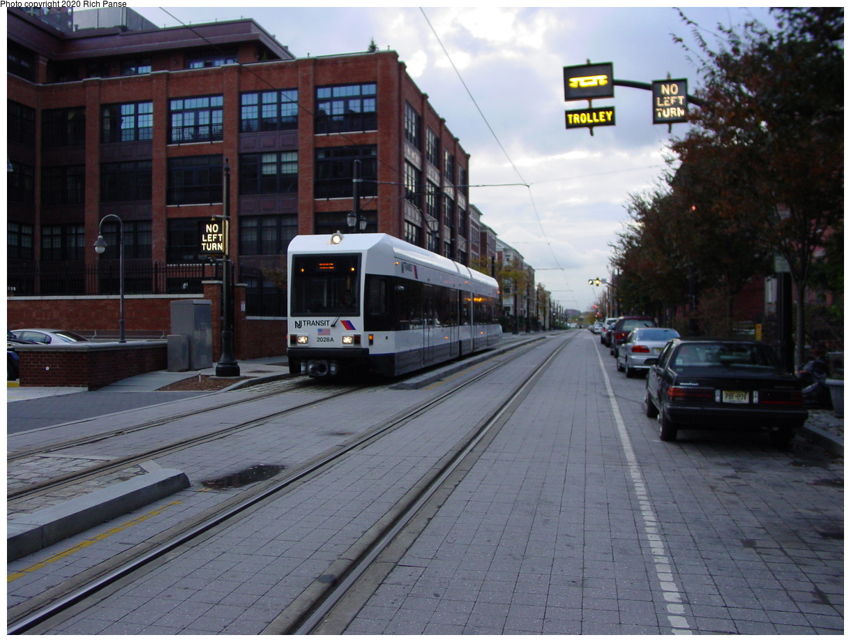 (81k, 820x620)<br><b>Country:</b> United States<br><b>City:</b> Jersey City, NJ<br><b>System:</b> Hudson Bergen Light Rail<br><b>Location:</b> Essex Street <br><b>Car:</b> NJT-HBLR LRV (Kinki-Sharyo, 1998-99)  2028 <br><b>Photo by:</b> Richard Panse<br><b>Date:</b> 10/29/2003<br><b>Viewed (this week/total):</b> 1 / 2841