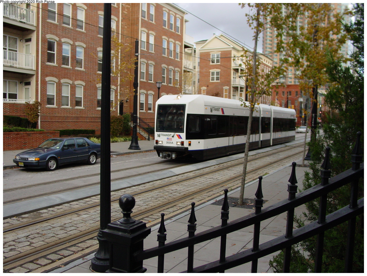 (103k, 820x620)<br><b>Country:</b> United States<br><b>City:</b> Jersey City, NJ<br><b>System:</b> Hudson Bergen Light Rail<br><b>Location:</b> Essex Street <br><b>Car:</b> NJT-HBLR LRV (Kinki-Sharyo, 1998-99)  2023 <br><b>Photo by:</b> Richard Panse<br><b>Date:</b> 10/29/2003<br><b>Viewed (this week/total):</b> 0 / 2725
