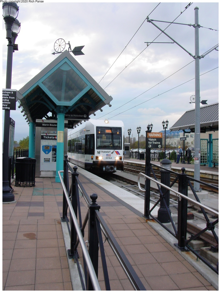 (81k, 622x823)<br><b>Country:</b> United States<br><b>City:</b> Jersey City, NJ<br><b>System:</b> Hudson Bergen Light Rail<br><b>Location:</b> Marin Boulevard <br><b>Car:</b> NJT-HBLR LRV (Kinki-Sharyo, 1998-99)  2016 <br><b>Photo by:</b> Richard Panse<br><b>Date:</b> 10/29/2003<br><b>Viewed (this week/total):</b> 2 / 2377