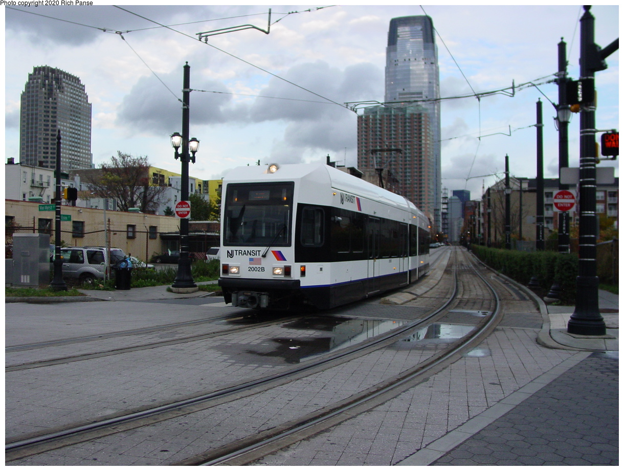 (80k, 820x620)<br><b>Country:</b> United States<br><b>City:</b> Jersey City, NJ<br><b>System:</b> Hudson Bergen Light Rail<br><b>Location:</b> Van Vorst Street <br><b>Car:</b> NJT-HBLR LRV (Kinki-Sharyo, 1998-99)  2002 <br><b>Photo by:</b> Richard Panse<br><b>Date:</b> 10/29/2003<br><b>Viewed (this week/total):</b> 0 / 2978