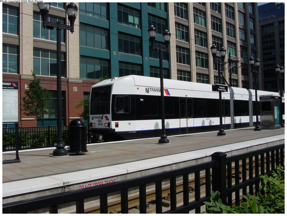 (97k, 820x620)<br><b>Country:</b> United States<br><b>City:</b> Jersey City, NJ<br><b>System:</b> Hudson Bergen Light Rail<br><b>Location:</b> Harborside <br><b>Car:</b> NJT-HBLR LRV (Kinki-Sharyo, 1998-99)  2004 <br><b>Photo by:</b> Richard Panse<br><b>Date:</b> 6/16/2003<br><b>Viewed (this week/total):</b> 0 / 2077