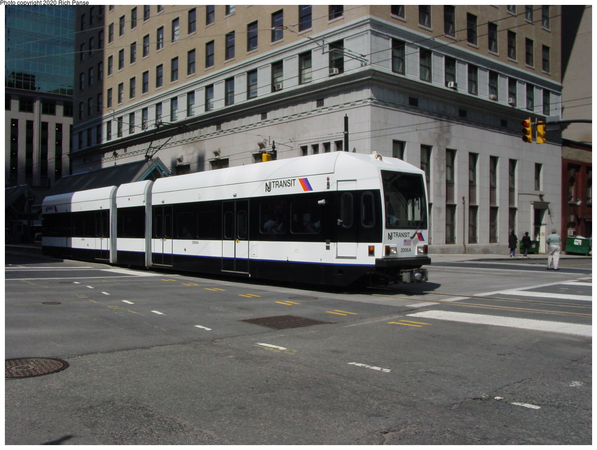 (82k, 820x620)<br><b>Country:</b> United States<br><b>City:</b> Jersey City, NJ<br><b>System:</b> Hudson Bergen Light Rail<br><b>Location:</b> Exchange Place <br><b>Car:</b> NJT-HBLR LRV (Kinki-Sharyo, 1998-99)  2006 <br><b>Photo by:</b> Richard Panse<br><b>Date:</b> 6/16/2003<br><b>Viewed (this week/total):</b> 0 / 2203