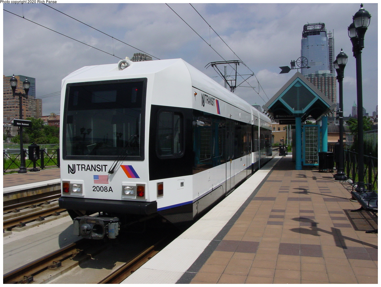 (74k, 820x620)<br><b>Country:</b> United States<br><b>City:</b> Jersey City, NJ<br><b>System:</b> Hudson Bergen Light Rail<br><b>Location:</b> Marin Boulevard <br><b>Car:</b> NJT-HBLR LRV (Kinki-Sharyo, 1998-99)  2008 <br><b>Photo by:</b> Richard Panse<br><b>Date:</b> 6/16/2003<br><b>Viewed (this week/total):</b> 0 / 2488