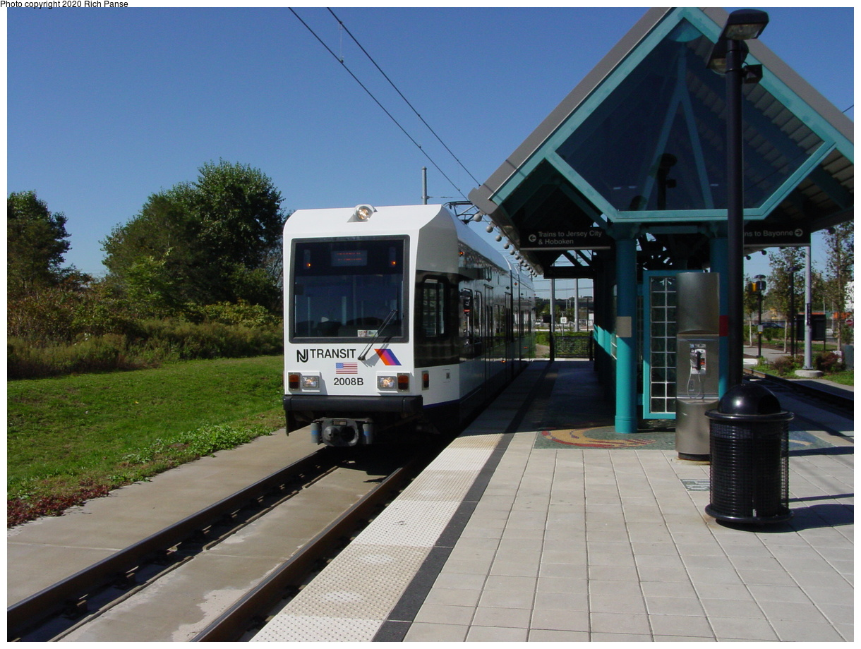 (78k, 820x620)<br><b>Country:</b> United States<br><b>City:</b> Jersey City, NJ<br><b>System:</b> Hudson Bergen Light Rail<br><b>Location:</b> Jersey Avenue <br><b>Car:</b> NJT-HBLR LRV (Kinki-Sharyo, 1998-99)  2008 <br><b>Photo by:</b> Richard Panse<br><b>Date:</b> 10/13/2003<br><b>Viewed (this week/total):</b> 0 / 2548