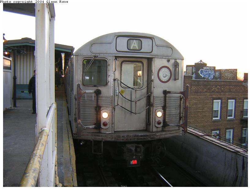 (95k, 820x620)<br><b>Country:</b> United States<br><b>City:</b> New York<br><b>System:</b> New York City Transit<br><b>Line:</b> IND Fulton Street Line<br><b>Location:</b> Lefferts Boulevard <br><b>Route:</b> A<br><b>Car:</b> R-38 (St. Louis, 1966-1967)  4133 <br><b>Photo by:</b> Glenn L. Rowe<br><b>Date:</b> 12/16/2003<br><b>Viewed (this week/total):</b> 0 / 4059
