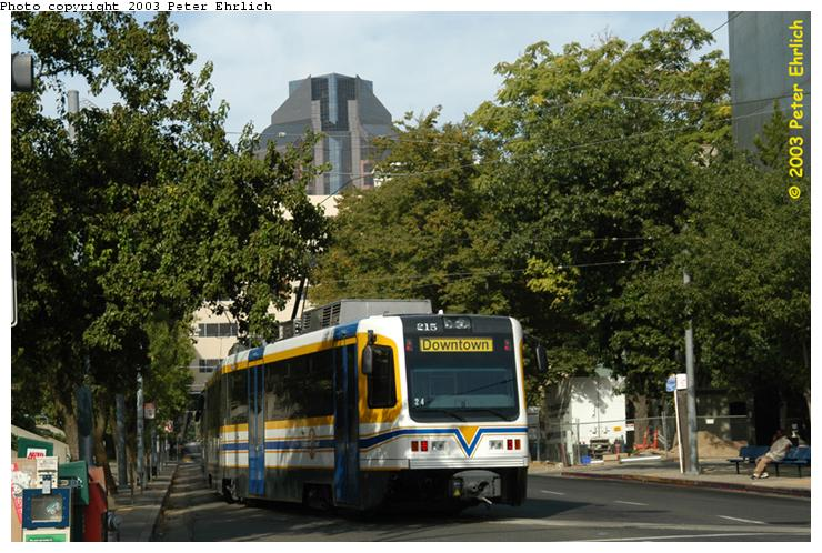 (89k, 740x498)<br><b>Country:</b> United States<br><b>City:</b> Sacramento, CA<br><b>System:</b> SACRT Light Rail<br><b>Location:</b> 8th & O <br><b>Car:</b> Sacramento CAF LRV  215 <br><b>Photo by:</b> Peter Ehrlich<br><b>Date:</b> 10/18/2003<br><b>Viewed (this week/total):</b> 0 / 1118