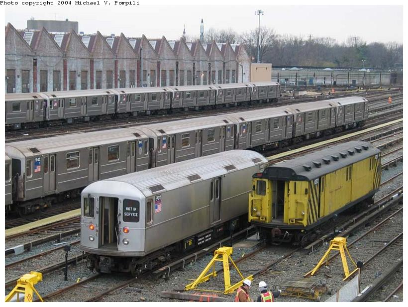 (110k, 820x617)<br><b>Country:</b> United States<br><b>City:</b> New York<br><b>System:</b> New York City Transit<br><b>Location:</b> Corona Yard<br><b>Car:</b> R-127/R-134 (Kawasaki, 1991-1996) EP012 <br><b>Photo by:</b> Michael Pompili<br><b>Date:</b> 12/5/2003<br><b>Notes:</b> W/ R14 RD322<br><b>Viewed (this week/total):</b> 2 / 3844
