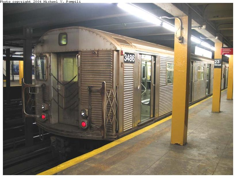 (84k, 820x620)<br><b>Country:</b> United States<br><b>City:</b> New York<br><b>System:</b> New York City Transit<br><b>Line:</b> IND 8th Avenue Line<br><b>Location:</b> 23rd Street <br><b>Route:</b> E<br><b>Car:</b> R-32 (Budd, 1964)  3486 <br><b>Photo by:</b> Michael Pompili<br><b>Date:</b> 12/4/2003<br><b>Viewed (this week/total):</b> 0 / 12492