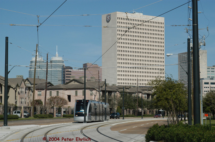 (152k, 720x478)<br><b>Country:</b> United States<br><b>City:</b> Houston, TX<br><b>System:</b> Houston METRORail<br><b>Location:</b> Braeswood & Greenbriar <br><b>Car:</b> Siemens Avanto 104 <br><b>Photo by:</b> Peter Ehrlich<br><b>Date:</b> 2/6/2004<br><b>Notes:</b> View east from Braeswood and Greenbriar.  The twin towers are St. Luke's.<br><b>Viewed (this week/total):</b> 4 / 3437