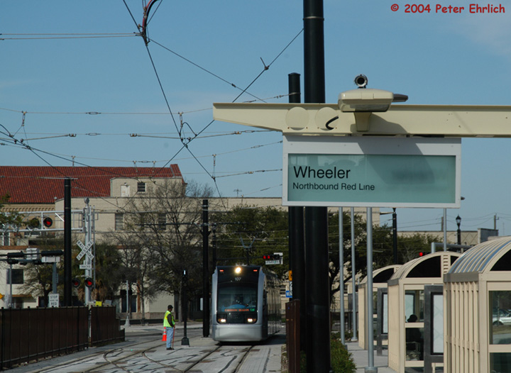 (138k, 720x526)<br><b>Country:</b> United States<br><b>City:</b> Houston, TX<br><b>System:</b> Houston METRORail<br><b>Location:</b> Wheeler <br><b>Car:</b> Siemens Avanto 107 <br><b>Photo by:</b> Peter Ehrlich<br><b>Date:</b> 2/6/2004<br><b>Notes:</b> Metro was running in both directions on the northbound track between Wheeler and Downtown Transit Center Stations during the wire tear-down in the Midtown Segment on Feb. 6. 107 is running southbound.<br><b>Viewed (this week/total):</b> 3 / 2838
