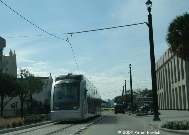 (110k, 720x516)<br><b>Country:</b> United States<br><b>City:</b> Houston, TX<br><b>System:</b> Houston METRORail<br><b>Location:</b> Main & Stuart <br><b>Car:</b> Siemens Avanto 108 <br><b>Photo by:</b> Peter Ehrlich<br><b>Date:</b> 2/6/2004<br><b>Notes:</b> A truck pulled the wires down on the outbound track at Ensemble/HCC Station and car 108 is stranded at Main & Stuart.<br><b>Viewed (this week/total):</b> 1 / 2482