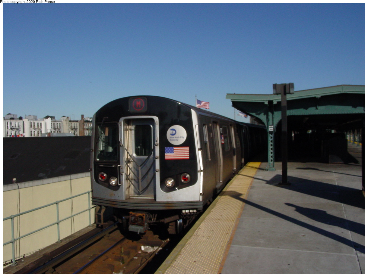 (67k, 820x620)<br><b>Country:</b> United States<br><b>City:</b> New York<br><b>System:</b> New York City Transit<br><b>Line:</b> BMT Myrtle Avenue Line<br><b>Location:</b> Fresh Pond Road <br><b>Route:</b> M<br><b>Car:</b> R-143 (Kawasaki, 2001-2002) 8276 <br><b>Photo by:</b> Richard Panse<br><b>Date:</b> 11/9/2003<br><b>Viewed (this week/total):</b> 4 / 3593