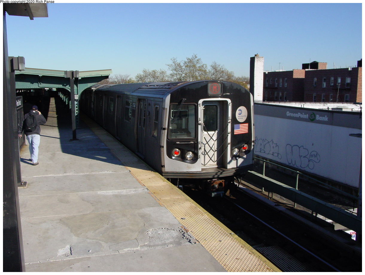(77k, 820x620)<br><b>Country:</b> United States<br><b>City:</b> New York<br><b>System:</b> New York City Transit<br><b>Line:</b> BMT Myrtle Avenue Line<br><b>Location:</b> Fresh Pond Road <br><b>Route:</b> M<br><b>Car:</b> R-143 (Kawasaki, 2001-2002) 8124 <br><b>Photo by:</b> Richard Panse<br><b>Date:</b> 11/9/2003<br><b>Viewed (this week/total):</b> 0 / 5007