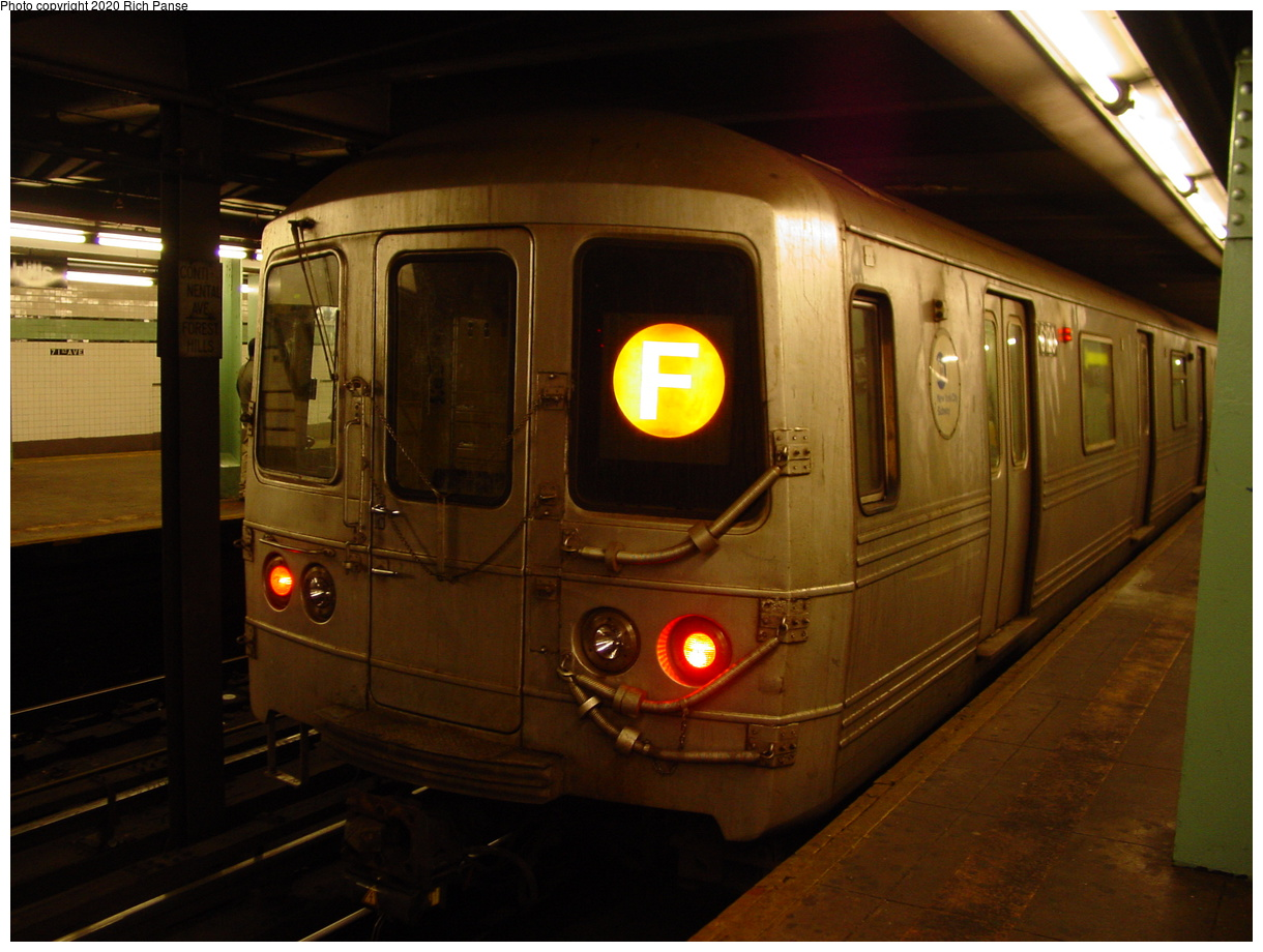 (63k, 820x620)<br><b>Country:</b> United States<br><b>City:</b> New York<br><b>System:</b> New York City Transit<br><b>Line:</b> IND Queens Boulevard Line<br><b>Location:</b> 71st/Continental Aves./Forest Hills <br><b>Route:</b> F<br><b>Car:</b> R-46 (Pullman-Standard, 1974-75) 6120 <br><b>Photo by:</b> Richard Panse<br><b>Date:</b> 2/4/2004<br><b>Viewed (this week/total):</b> 3 / 5193