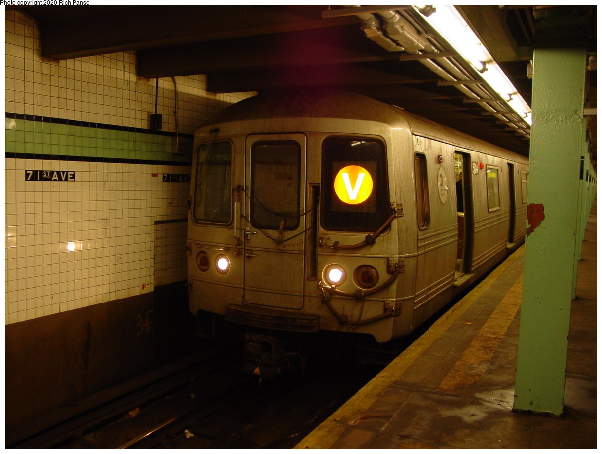 (75k, 820x620)<br><b>Country:</b> United States<br><b>City:</b> New York<br><b>System:</b> New York City Transit<br><b>Line:</b> IND Queens Boulevard Line<br><b>Location:</b> 71st/Continental Aves./Forest Hills <br><b>Route:</b> V<br><b>Car:</b> R-46 (Pullman-Standard, 1974-75) 5814 <br><b>Photo by:</b> Richard Panse<br><b>Date:</b> 2/4/2004<br><b>Viewed (this week/total):</b> 0 / 4725