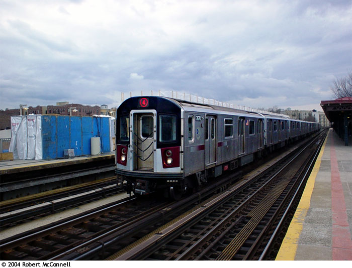(83k, 700x534)<br><b>Country:</b> United States<br><b>City:</b> New York<br><b>System:</b> New York City Transit<br><b>Line:</b> IRT Woodlawn Line<br><b>Location:</b> Bedford Park Boulevard <br><b>Route:</b> 4<br><b>Car:</b> R-142A (Option Order, Kawasaki, 2002-2003)  7670 <br><b>Photo by:</b> Robert McConnell<br><b>Date:</b> 4/4/2004<br><b>Viewed (this week/total):</b> 3 / 3882