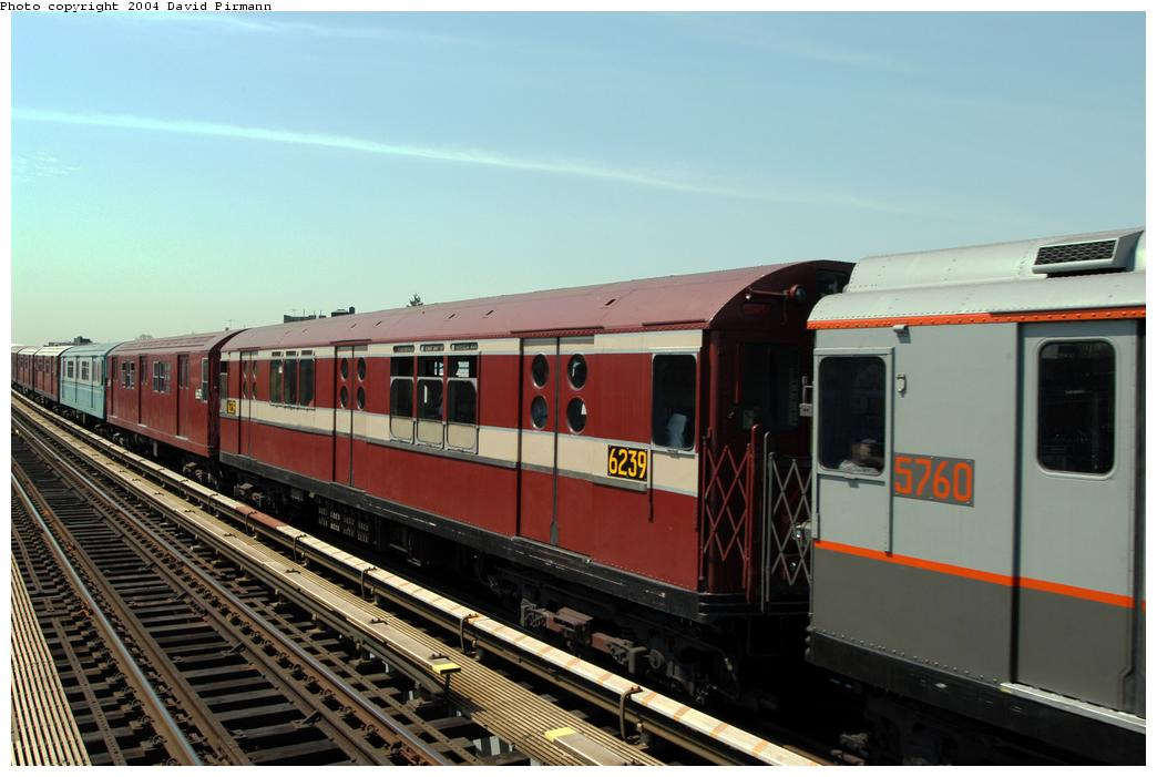 (144k, 1044x701)<br><b>Country:</b> United States<br><b>City:</b> New York<br><b>System:</b> New York City Transit<br><b>Line:</b> IRT Pelham Line<br><b>Location:</b> Zerega Avenue <br><b>Route:</b> Fan Trip<br><b>Car:</b> R-15 (American Car & Foundry, 1950) 6239 <br><b>Photo by:</b> David Pirmann<br><b>Date:</b> 4/17/2004<br><b>Viewed (this week/total):</b> 1 / 2186