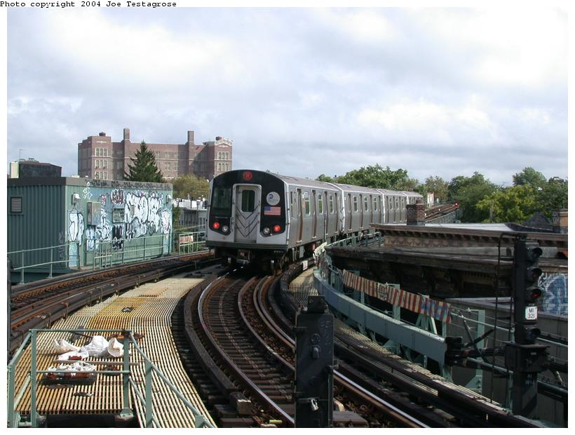 (118k, 820x620)<br><b>Country:</b> United States<br><b>City:</b> New York<br><b>System:</b> New York City Transit<br><b>Line:</b> BMT Myrtle Avenue Line<br><b>Location:</b> Seneca Avenue <br><b>Route:</b> M<br><b>Car:</b> R-143 (Kawasaki, 2001-2002) 8216 <br><b>Photo by:</b> Joe Testagrose<br><b>Date:</b> 9/27/2003<br><b>Viewed (this week/total):</b> 1 / 3973