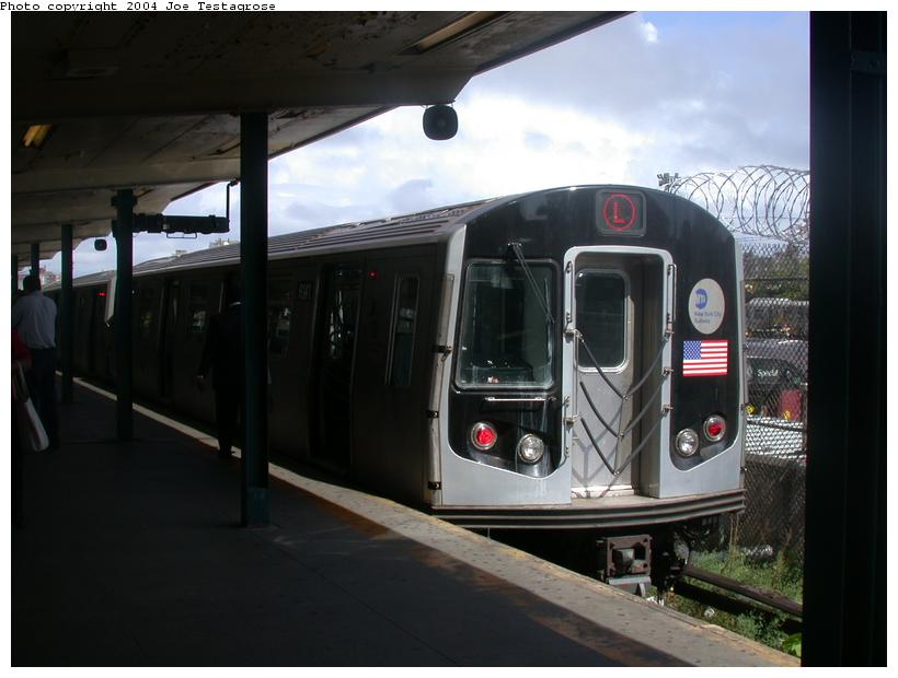 (92k, 820x620)<br><b>Country:</b> United States<br><b>City:</b> New York<br><b>System:</b> New York City Transit<br><b>Line:</b> BMT Canarsie Line<br><b>Location:</b> Rockaway Parkway <br><b>Route:</b> M<br><b>Car:</b> R-143 (Kawasaki, 2001-2002) 8141 <br><b>Photo by:</b> Joe Testagrose<br><b>Date:</b> 9/27/2003<br><b>Viewed (this week/total):</b> 3 / 3063