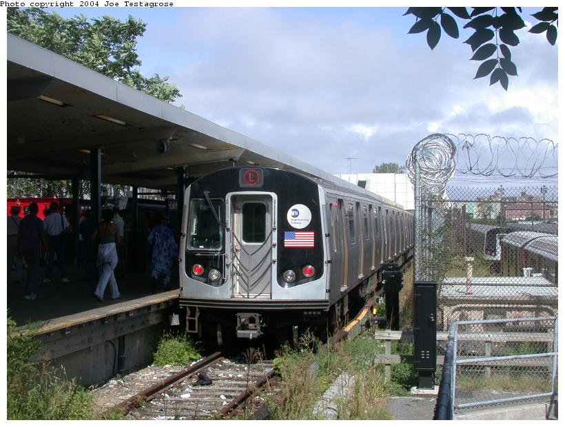 (128k, 820x620)<br><b>Country:</b> United States<br><b>City:</b> New York<br><b>System:</b> New York City Transit<br><b>Line:</b> BMT Canarsie Line<br><b>Location:</b> Rockaway Parkway <br><b>Route:</b> M<br><b>Car:</b> R-143 (Kawasaki, 2001-2002) 8141 <br><b>Photo by:</b> Joe Testagrose<br><b>Date:</b> 9/27/2003<br><b>Viewed (this week/total):</b> 0 / 4259