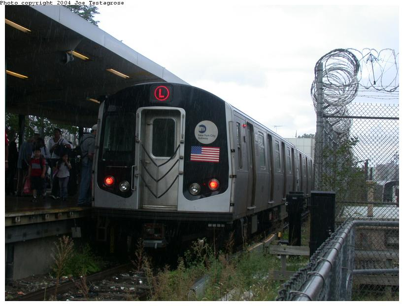 (106k, 820x620)<br><b>Country:</b> United States<br><b>City:</b> New York<br><b>System:</b> New York City Transit<br><b>Line:</b> BMT Canarsie Line<br><b>Location:</b> Rockaway Parkway <br><b>Route:</b> M<br><b>Car:</b> R-143 (Kawasaki, 2001-2002) 8136 <br><b>Photo by:</b> Joe Testagrose<br><b>Date:</b> 9/27/2003<br><b>Viewed (this week/total):</b> 2 / 3598