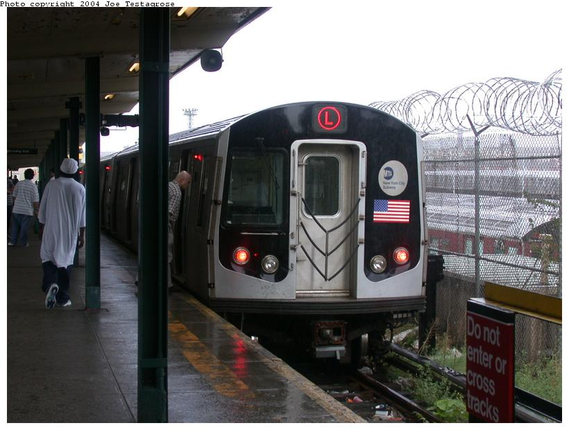 (111k, 820x620)<br><b>Country:</b> United States<br><b>City:</b> New York<br><b>System:</b> New York City Transit<br><b>Line:</b> BMT Canarsie Line<br><b>Location:</b> Rockaway Parkway <br><b>Route:</b> M<br><b>Car:</b> R-143 (Kawasaki, 2001-2002) 8136 <br><b>Photo by:</b> Joe Testagrose<br><b>Date:</b> 9/27/2003<br><b>Viewed (this week/total):</b> 1 / 3179