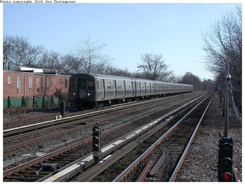 (140k, 820x620)<br><b>Country:</b> United States<br><b>City:</b> New York<br><b>System:</b> New York City Transit<br><b>Line:</b> BMT Brighton Line<br><b>Location:</b> Neck Road <br><b>Route:</b> Q<br><b>Car:</b> R-68 (Westinghouse-Amrail, 1986-1988)  2886 <br><b>Photo by:</b> Joe Testagrose<br><b>Date:</b> 2/28/2004<br><b>Viewed (this week/total):</b> 1 / 3055