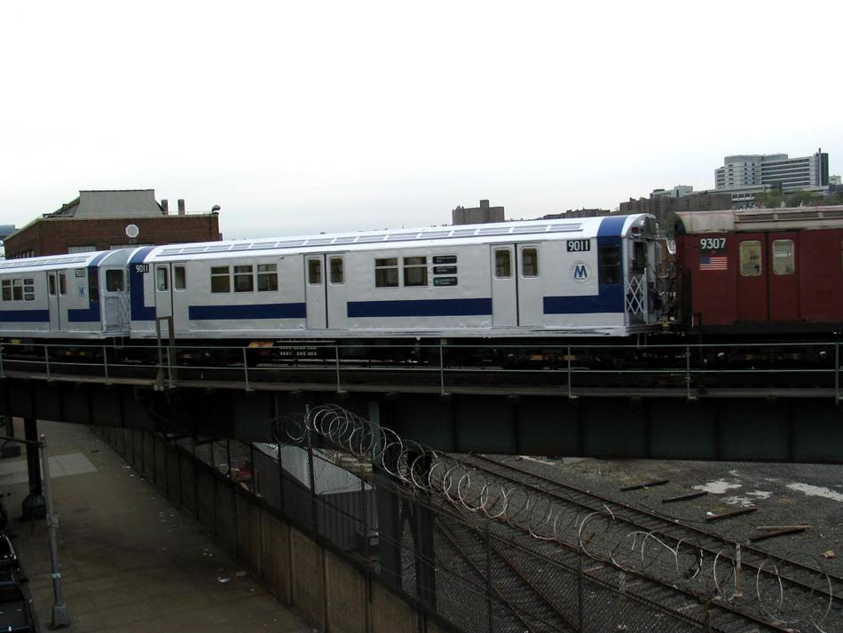 (69k, 950x713)<br><b>Country:</b> United States<br><b>City:</b> New York<br><b>System:</b> New York City Transit<br><b>Location:</b> 207th Street Yard<br><b>Route:</b> Fan Trip<br><b>Car:</b> R-33 Main Line (St. Louis, 1962-63) 9011 <br><b>Photo by:</b> David of Broadway<br><b>Date:</b> 4/25/2004<br><b>Viewed (this week/total):</b> 7 / 2496