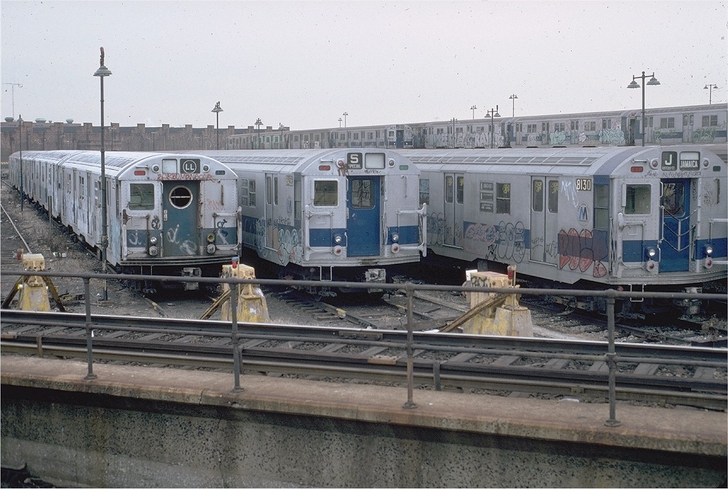 (219k, 1024x688)<br><b>Country:</b> United States<br><b>City:</b> New York<br><b>System:</b> New York City Transit<br><b>Location:</b> East New York Yard/Shops<br><b>Car:</b> R-16 (American Car & Foundry, 1955) 6413 <br><b>Photo by:</b> Doug Grotjahn<br><b>Collection of:</b> Joe Testagrose<br><b>Date:</b> 12/7/1980<br><b>Notes:</b> with R27/30 8456-8130<br><b>Viewed (this week/total):</b> 0 / 5699