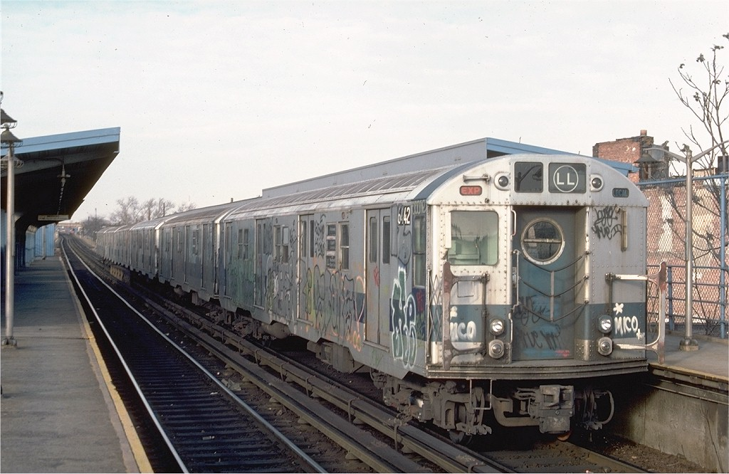 (179k, 1024x666)<br><b>Country:</b> United States<br><b>City:</b> New York<br><b>System:</b> New York City Transit<br><b>Line:</b> BMT Canarsie Line<br><b>Location:</b> New Lots Avenue <br><b>Route:</b> LL<br><b>Car:</b> R-16 (American Car & Foundry, 1955) 6442 <br><b>Photo by:</b> Ed McKernan<br><b>Collection of:</b> Joe Testagrose<br><b>Date:</b> 12/22/1976<br><b>Viewed (this week/total):</b> 0 / 4276