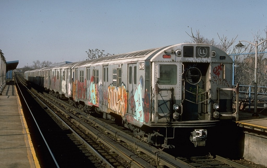 (193k, 1024x644)<br><b>Country:</b> United States<br><b>City:</b> New York<br><b>System:</b> New York City Transit<br><b>Line:</b> BMT Canarsie Line<br><b>Location:</b> New Lots Avenue <br><b>Route:</b> LL<br><b>Car:</b> R-16 (American Car & Foundry, 1955) 6498 <br><b>Photo by:</b> Ed McKernan<br><b>Collection of:</b> Joe Testagrose<br><b>Date:</b> 3/21/1977<br><b>Viewed (this week/total):</b> 6 / 4944