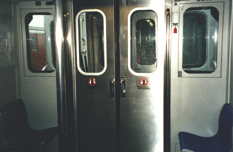 (61k, 750x490)<br><b>Country:</b> United States<br><b>City:</b> New York<br><b>System:</b> New York City Transit<br><b>Car:</b> R-110A (Kawasaki, 1992) Interior <br><b>Photo by:</b> Steve Kreisler<br><b>Date:</b> 1997<br><b>Notes:</b> Interior end door<br><b>Viewed (this week/total):</b> 3 / 6629