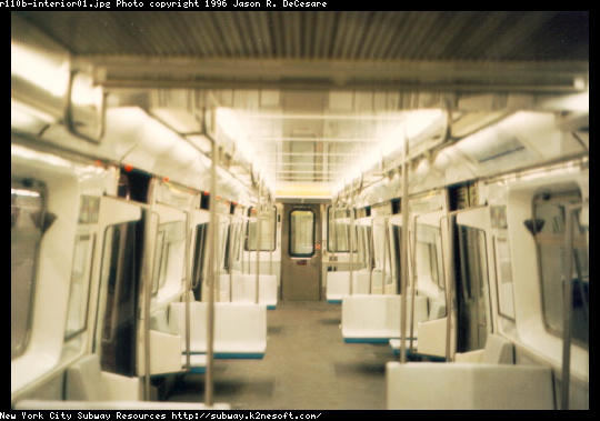 (38k, 540x379)<br><b>Country:</b> United States<br><b>City:</b> New York<br><b>System:</b> New York City Transit<br><b>Car:</b> R-110B (Bombardier, 1992) Interior <br><b>Photo by:</b> Jason R. DeCesare<br><b>Date:</b> 1997<br><b>Notes:</b> Interior, white color scheme<br><b>Viewed (this week/total):</b> 4 / 22411