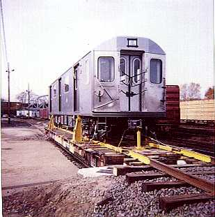 (18k, 309x311)<br><b>Country:</b> United States<br><b>City:</b> New York<br><b>System:</b> New York City Transit<br><b>Location:</b> LIRR/NY & Atlantic RR Fresh Pond Yard <br><b>Car:</b> R-142 or R-142A (Number Unknown)  <br><b>Photo by:</b> Bernard Ente<br><b>Date:</b> 11/1999<br><b>Notes:</b> First delivery of Bombardier R142 cars.<br><b>Viewed (this week/total):</b> 3 / 9609