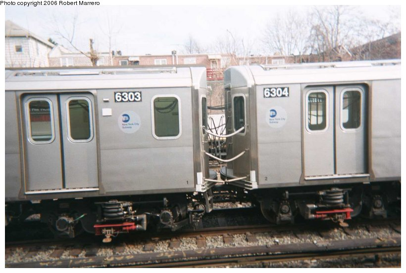(79k, 820x553)<br><b>Country:</b> United States<br><b>City:</b> New York<br><b>System:</b> New York City Transit<br><b>Line:</b> IRT Dyre Ave. Line<br><b>Location:</b> Gun Hill Road <br><b>Car:</b> R-142 (Primary Order, Bombardier, 1999-2002)  6303 <br><b>Photo by:</b> Robert Marrero<br><b>Viewed (this week/total):</b> 7 / 8101