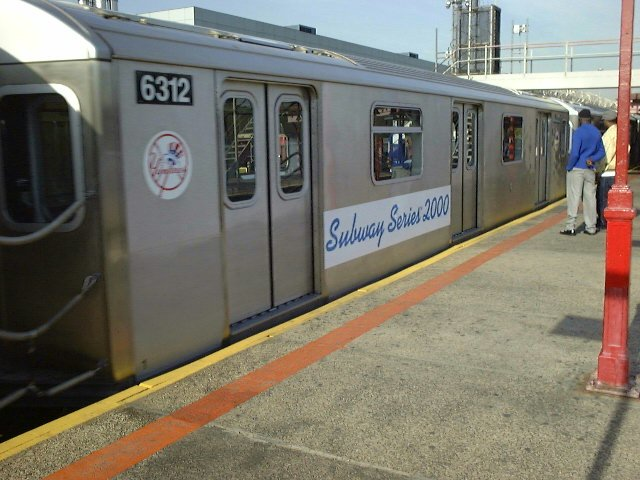 (77k, 640x480)<br><b>Country:</b> United States<br><b>City:</b> New York<br><b>System:</b> New York City Transit<br><b>Line:</b> IRT White Plains Road Line<br><b>Location:</b> East 180th Street <br><b>Car:</b> R-142 (Primary Order, Bombardier, 1999-2002)  6312 <br><b>Photo by:</b> Trevor Logan<br><b>Date:</b> 10/21/2000<br><b>Notes:</b> World Series Special<br><b>Viewed (this week/total):</b> 0 / 5686