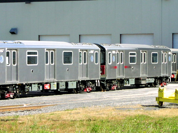(79k, 600x450)<br><b>Country:</b> United States<br><b>City:</b> New York<br><b>System:</b> New York City Transit<br><b>Location:</b> Bombardier Plant, Plattsburgh, NY<br><b>Car:</b> R-142 (Primary Order, Bombardier, 1999-2002)  6567 <br><b>Photo by:</b> Trevor Logan<br><b>Date:</b> 10/9/2001<br><b>Notes:</b> With R142 6801<br><b>Viewed (this week/total):</b> 0 / 4636