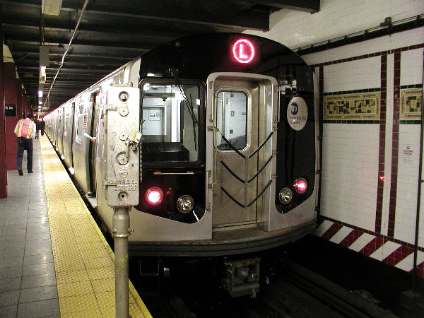 (88k, 600x450)<br><b>Country:</b> United States<br><b>City:</b> New York<br><b>System:</b> New York City Transit<br><b>Line:</b> BMT Canarsie Line<br><b>Location:</b> 8th Avenue <br><b>Route:</b> L<br><b>Car:</b> R-143 (Kawasaki, 2001-2002) 8101 <br><b>Photo by:</b> Trevor Logan<br><b>Date:</b> 12/4/2001<br><b>Viewed (this week/total):</b> 2 / 19633