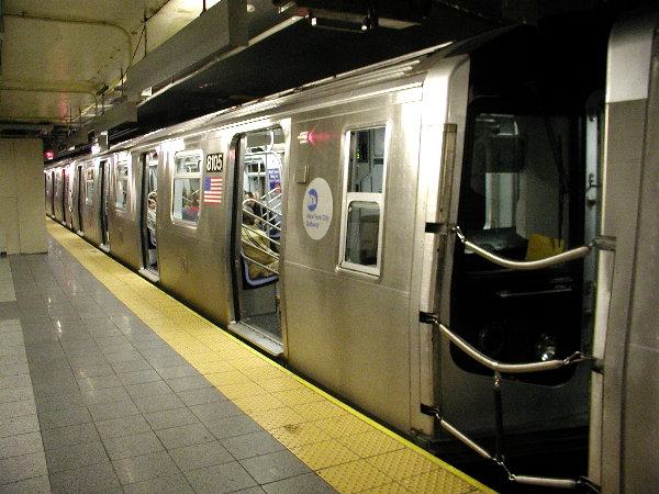 (82k, 600x450)<br><b>Country:</b> United States<br><b>City:</b> New York<br><b>System:</b> New York City Transit<br><b>Line:</b> BMT Canarsie Line<br><b>Location:</b> 8th Avenue <br><b>Route:</b> L<br><b>Car:</b> R-143 (Kawasaki, 2001-2002) 8105 <br><b>Photo by:</b> Trevor Logan<br><b>Date:</b> 12/4/2001<br><b>Viewed (this week/total):</b> 3 / 7079