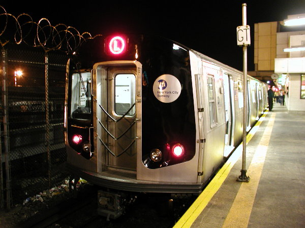 (75k, 600x450)<br><b>Country:</b> United States<br><b>City:</b> New York<br><b>System:</b> New York City Transit<br><b>Line:</b> BMT Canarsie Line<br><b>Location:</b> Rockaway Parkway <br><b>Route:</b> L<br><b>Car:</b> R-143 (Kawasaki, 2001-2002) 8101 <br><b>Photo by:</b> Trevor Logan<br><b>Date:</b> 12/4/2001<br><b>Viewed (this week/total):</b> 1 / 4958